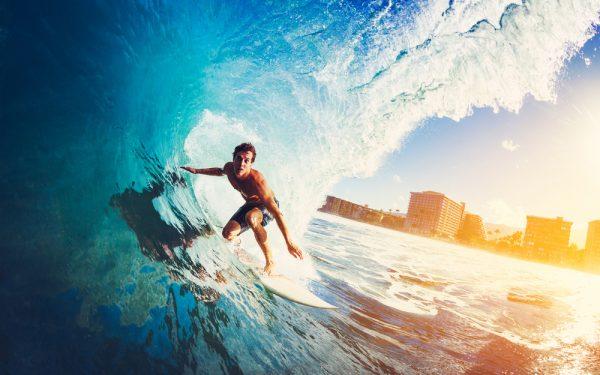 Surfer,On,Blue,Ocean,Wave,Getting,Barreled,At,Sunrise