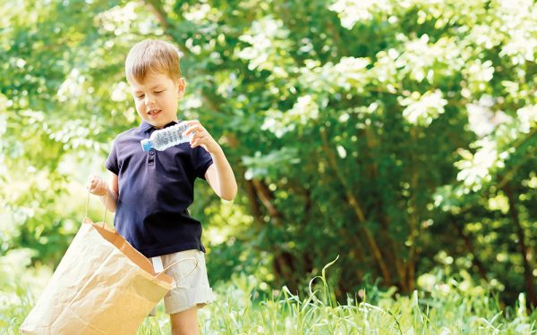 Environmental,Conservation,Concept.little,Boy,Collects,Garbage,And,Plastic,Bottles,In