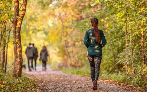 Woman,Walking,In,Autumn,Forest,Nature,Path,Walk,On,Trail