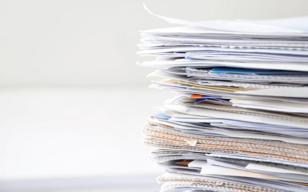 Pile,Of,Financial,Documents,On,White,Table,With,Copy,Space